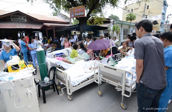 Right after the earthquake, hospitals move their operations outdoors. This was the scene outside the Tagbilaran City Community Hospital a day after the tremor. (Photography by Gerald Cabal)